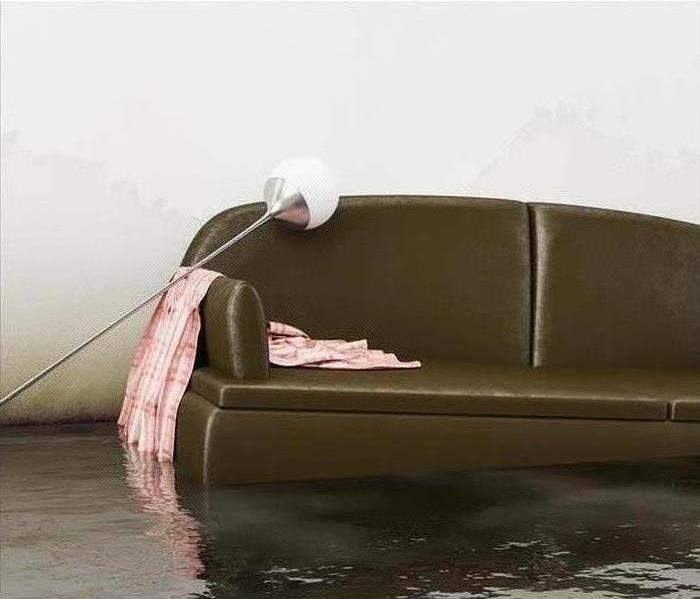 couch with lamp tilted onto it, flooding water rising around it and wicking up the walls
