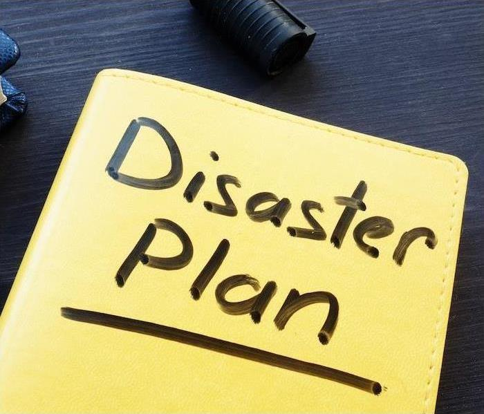 "Yellow book with ""Disaster Plan"" on the front"